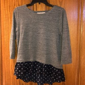 Grey Sweater top with navy underlay.